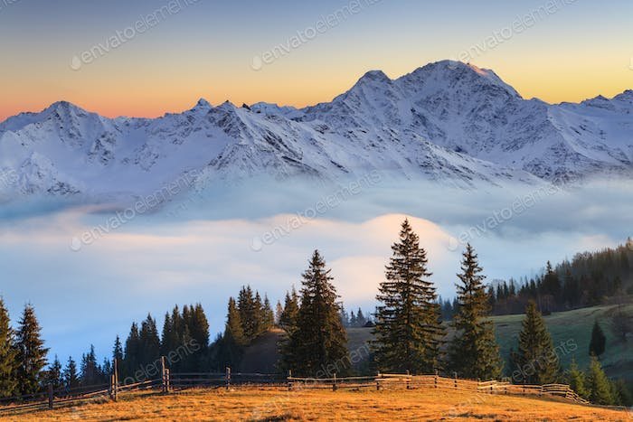 Beautiful mountain landscape in the misty sunrise. Alps, Austria