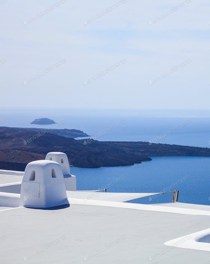 Santorini, Greece. White terrace against blue sea and sky background.