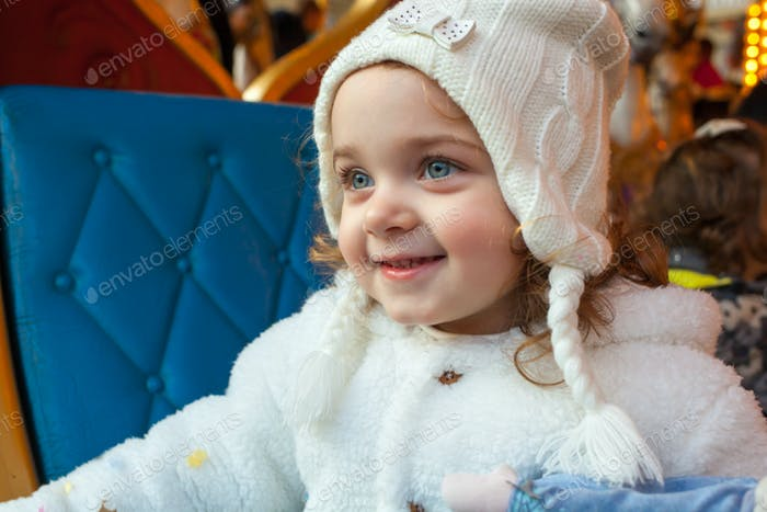 Beautiful toddler girl dressed as a carnival princess.