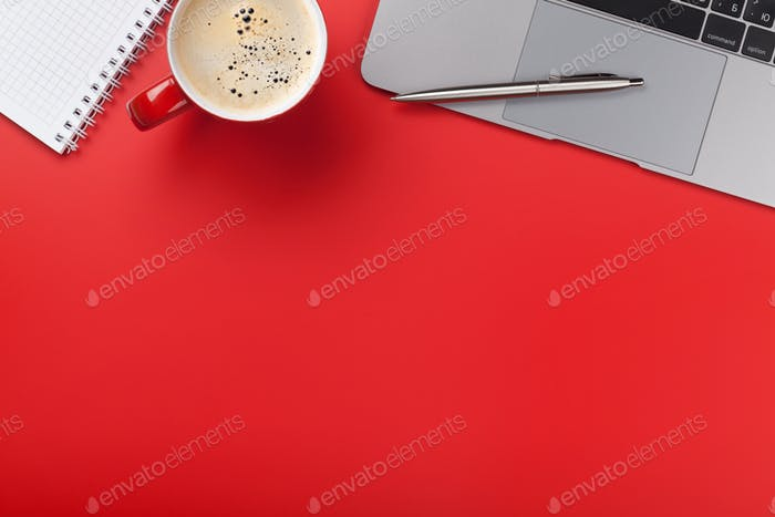Office red workplace with coffee cup, supplies and computer