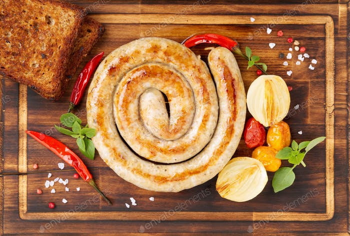 homemade fried sausage, spiral shape, with vegetables