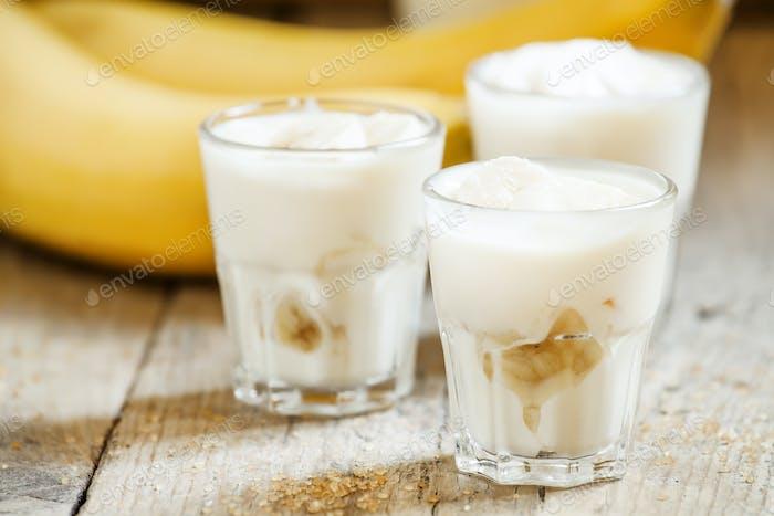 Fresh homemade banana yogurt in glass