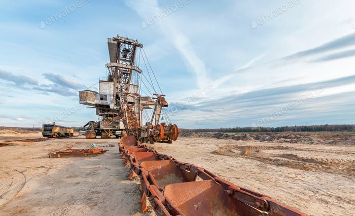 Broken rusty giant quarry excavator