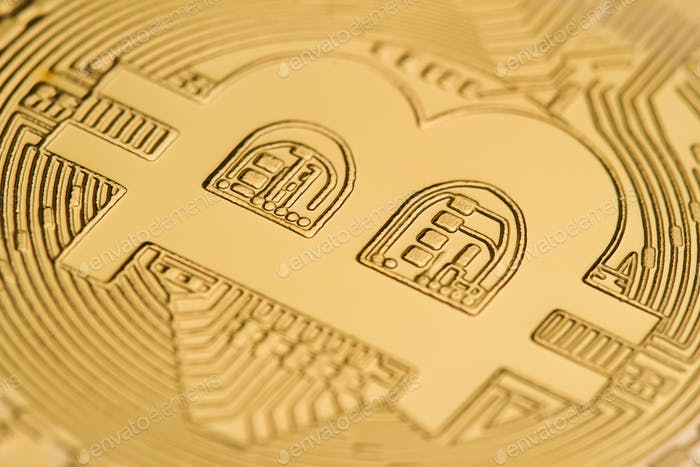 close up of on a golden coin bitcoin logo
