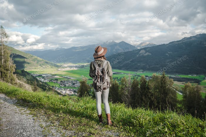 Young tourist with a backpack in Austria