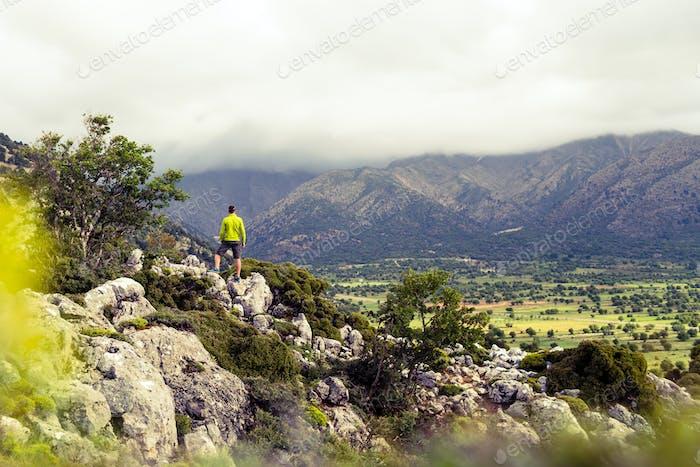 Hiking man looking at beautiful mountains