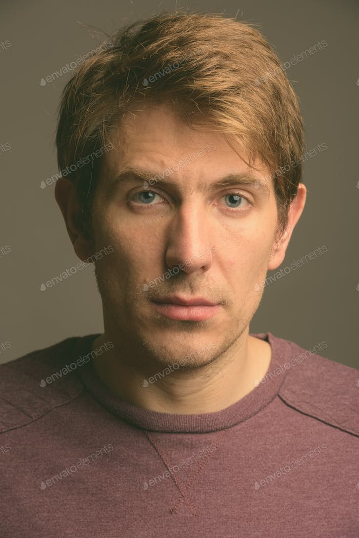 Handsome man against gray background