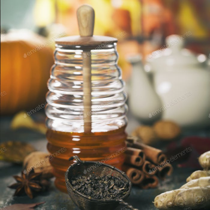 Autumn composition with honey. Warm and comfy autumn concept.
