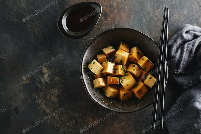 Chunks of tofu with sauce in bowl