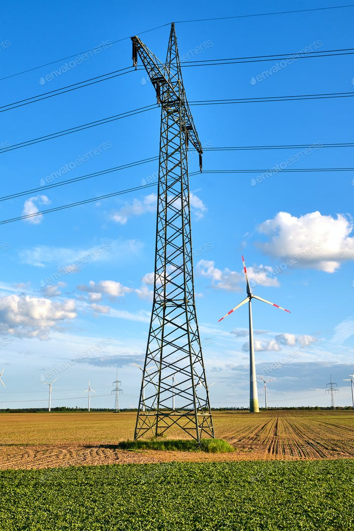 An electricity pylon with wind energy generators
