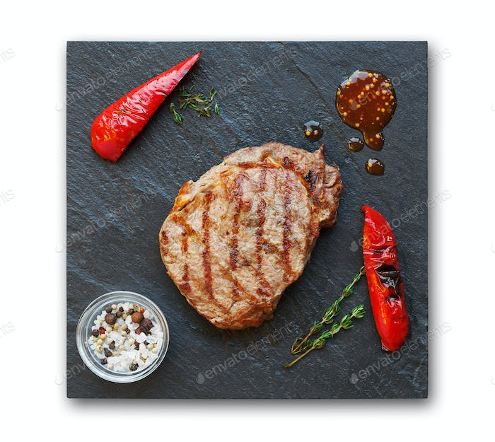 Grilled beef steak and pepprs isolated on white