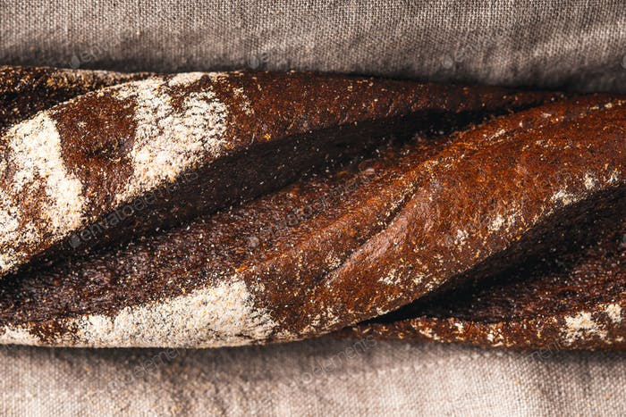 Baguette on the grey napkin close-up
