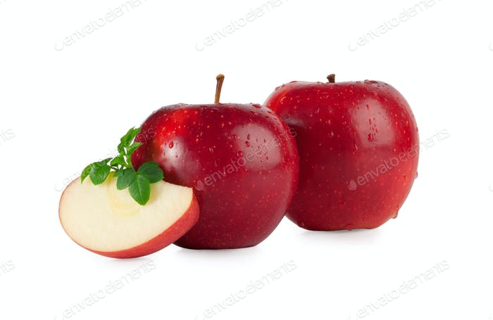 Red apples with drops and a slice