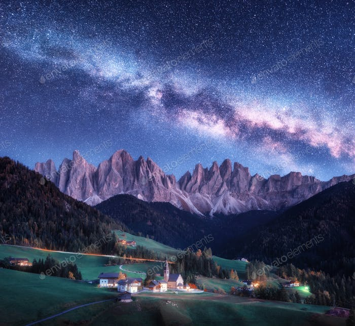 Santa Maddalena and Milky Way at night in autumn in Italy