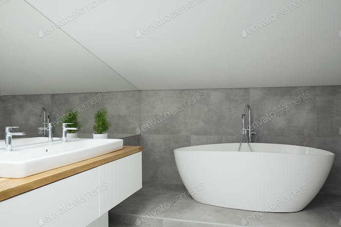Grey bathroom interior with bathtub
