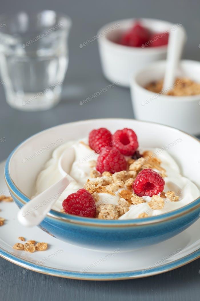 yogurt with granola and raspberry for healthy breakfast