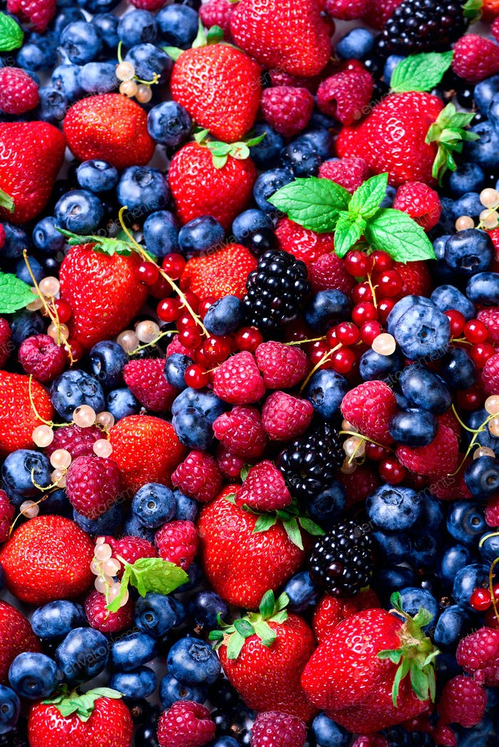 Assortment of strawberry, blueberry, raspberry, blackberry, currant, mint. Top view. Summer food
