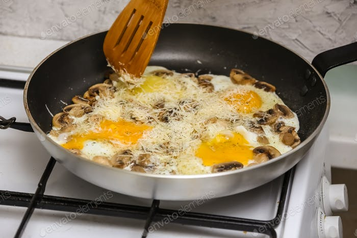 Fried eggs with mushrooms for a breakfast