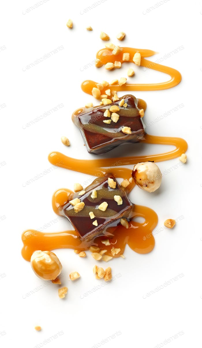 chocolate candies decorated with caramel sauce and nuts