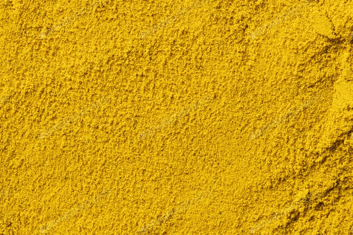 Background from curry powder close up