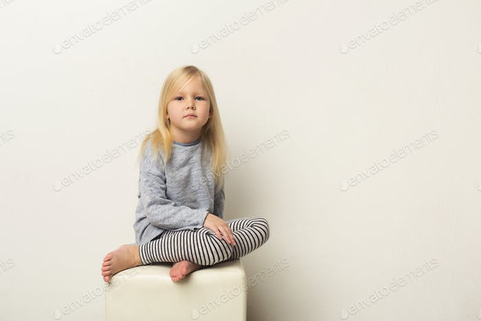 Cute happy little girl portrait in studio