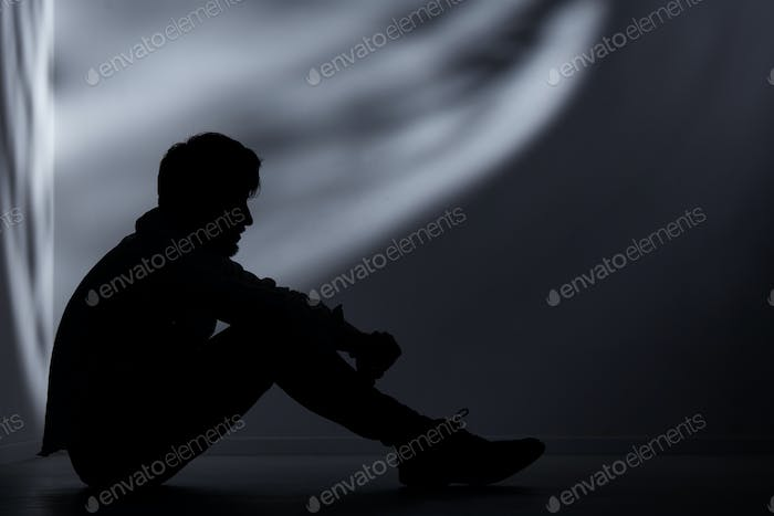 Abandoned man in dark room