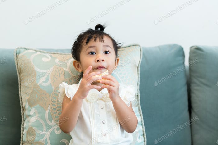 Little girl sitting on the couch