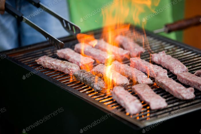 Delicious assorted grilled meat with vegetables over the coals on barbecue