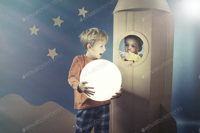 Boy showing the shining ball