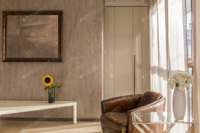 Stylish interior with leather armchair