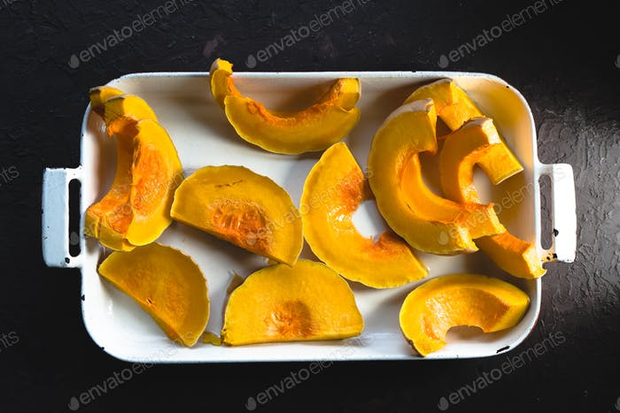 Large pieces of pumpkin in a baking dish