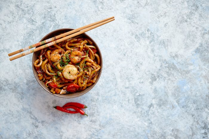 Traditional asian udon stir-fry noodles with shrimp