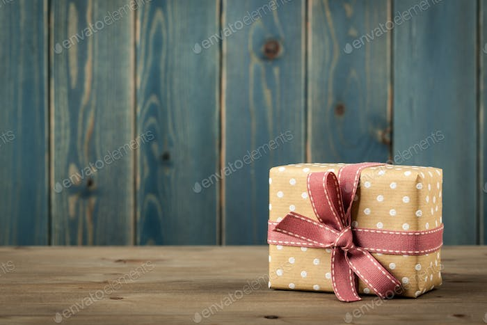 Polka dot gift box on wooden table