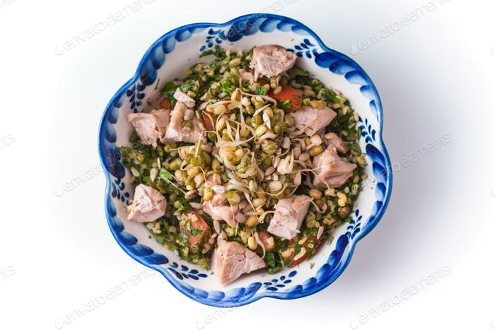 Ceramic bowl with wavy edges salad with beans and chicken