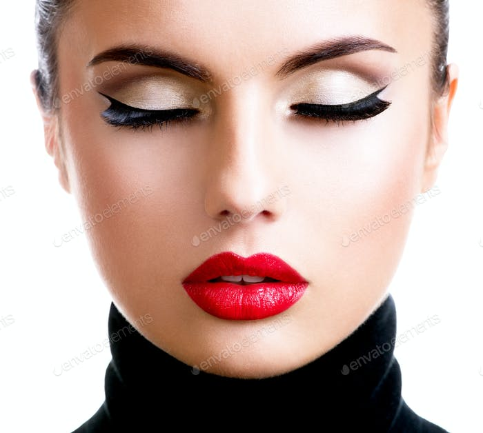 Beautiful young woman with fashion makeup.