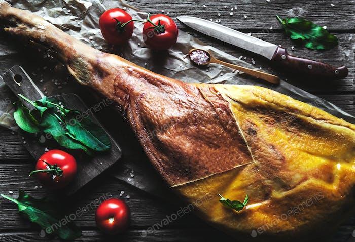 Sliced jamon on cutting board
