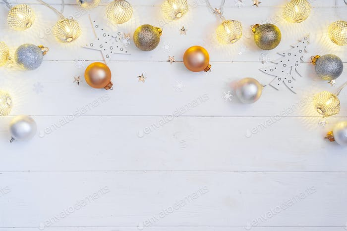 Christmas Holiday Balls and Christmas light balls on a white wooden background with copy space, flat