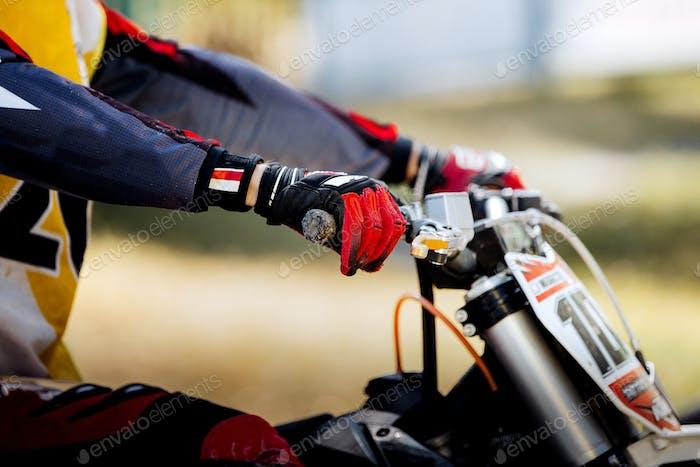 Hands racer on handlebar