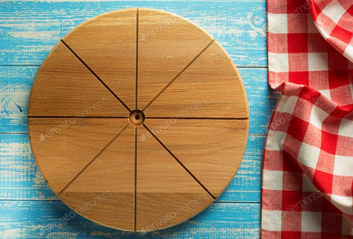 pizza cutting board at wood