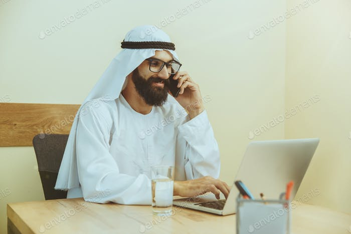 Arabian saudi businessman working in office
