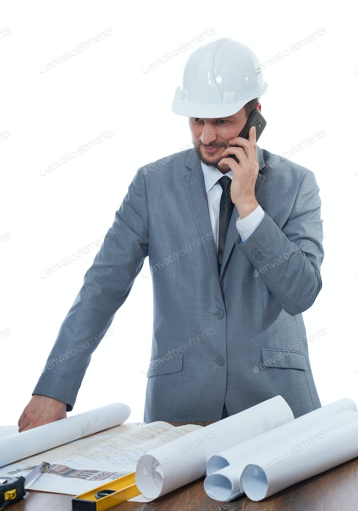 Architect talking on call phone at work place