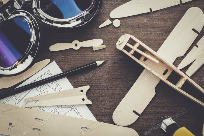handmade airplane on brown wooden table