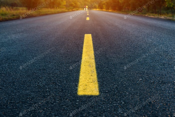 Yellow dashed line on empty asphalt road
