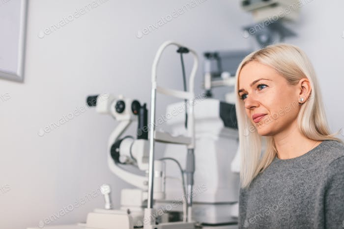 Woman sitting at the optician's office