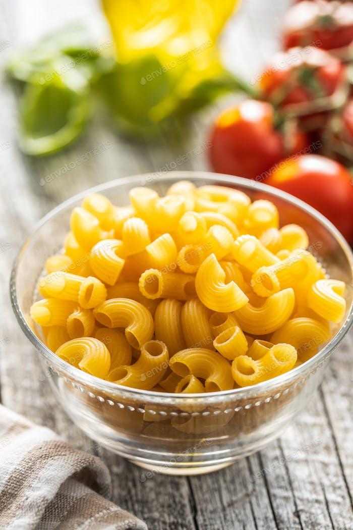 Raw italian pasta in glass bowl.