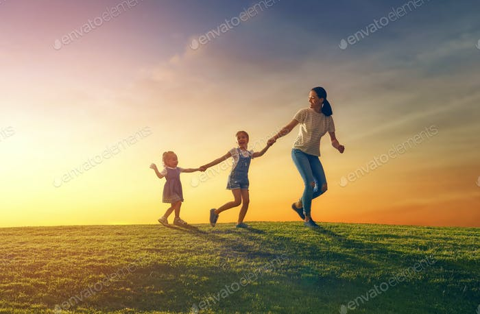 family having fun on nature