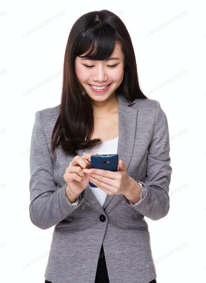 Businesswoman check email via cellphone