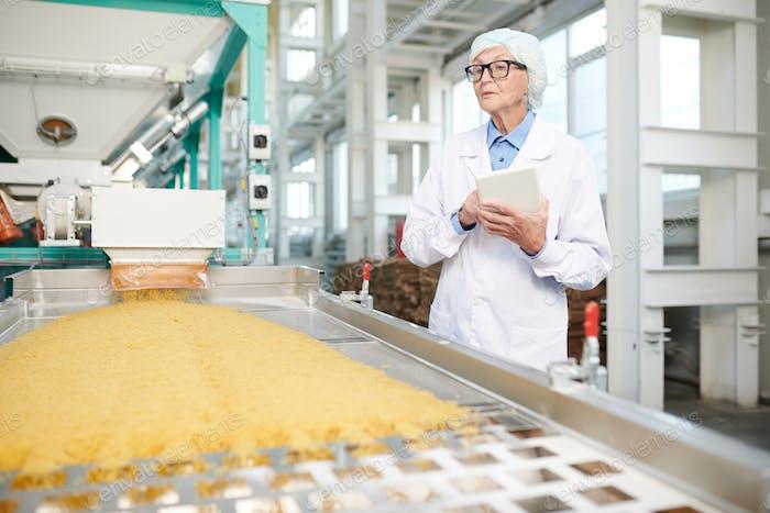Senior Woman Inspecting Production