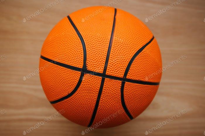Basketball ball on court floor