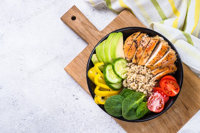 Buddha bowl quinoa salad with chicken and vegetables